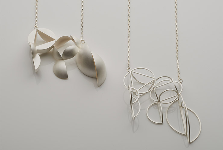 A pair of necklaces by Jo Hawley
