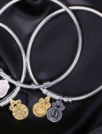 Offering Bangle with Sky's the Limit & Power Charms